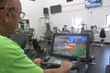 Chadron State College psychology adjunct Marv Neuharth hunts for a dragon while riding one of the Expresso Bike machines at the Nelson Physical Activity Center. In June 2018, Neuharth surpassed one billion points by playing the dragon killing game on the stationary bicycle that he rides three or four times a week. (George Ledbetter photo)