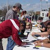 Head Cross Country Coach Brian Medigovich signs in at The Big Event volunteer tables at the Chicoine Center Saturday, April 22, 2017. (Photo by Tena L. Cook/Chadron State College)