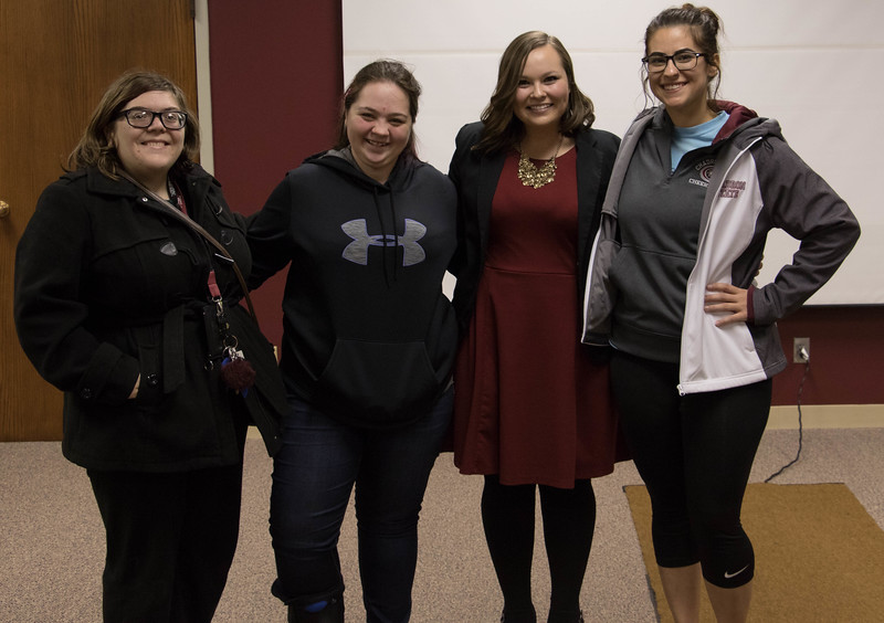 Chadron State College students, from left, Laurin Bronson, Selena Vogel and Gabi Perez, far right, pose with Sara Smith after her presentation, Dream Upon a Star, Tuesday, March 28, 2017, in the Student Center. (Photo by Kelsey R. Brummels/Chadron State College)
