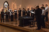 Dr. Joel Schreder, right, leads a performance by the men of the Chadron State College Concert Choir and CSC Community Chorus at the Chadron Arts Center Sunday, Nov. 11, 2018.  (Tena L. Cook/Chadron State College)