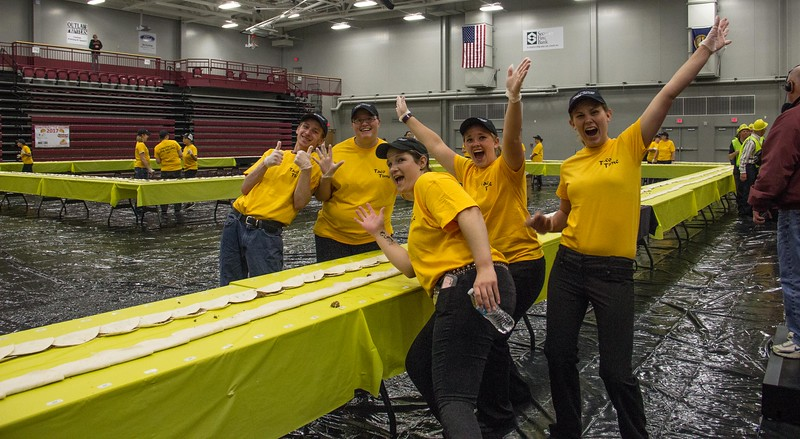 CSC Dining Services employees celebrate as they complete filling and folding 2,017 tacos in an attempt to set the world's record Friday, April 21, 2017 in the Chicoine Center. (Photo by Tena L. Cook/Chadron State College)