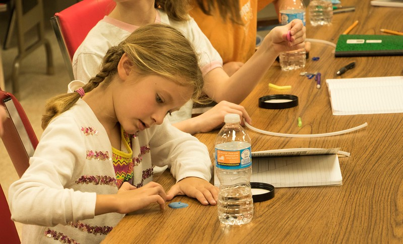 Lillian Johndrean flattens clay to make her thermometer during Science Saturday<br /> (Photo by Alex Coon/Chadron State College)