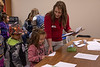 Assistant Professor Robin Brierly, right, helps Kindergarten students from Wolf Creek Elementary School near Pine Ridge, S.D. learn how to measure using a paper foot during Dr. Seuss Day Wednesday, Feb. 27, 2019, at Chadron State College as part of Read Across America. (Tena L. Cook/Chadron State College)