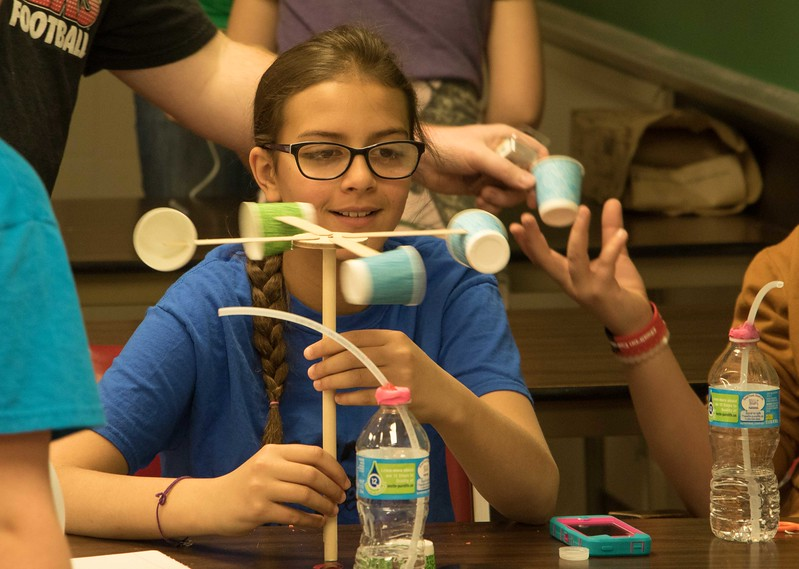 Blaine Tewahade uses her homemade anemometer during Science Saturday at Chadron State College Math and Science Building, Saturday, April 8, 2017.<br /> (Photo by Alex Coon/Chadron State College)