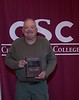 Craig LaFontsee, retiring maintenance repair worker II, poses with a plaque honoring him at the annual Chadron State College Faculty and Staff Recognition Luncheon Thursday, April 13, 2017, in the Student Center Ballroom. (Photo by Tena L. Cook/Chadron State College)