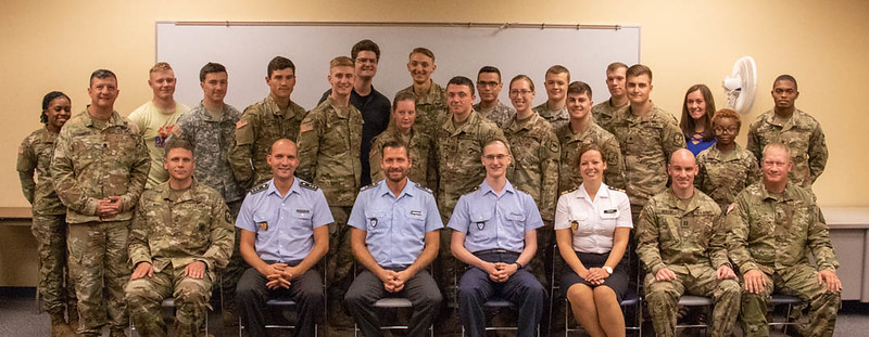 Chadron State College Army ROTC cadets, CSC faculty members, and leaders of the Rushmore Battalion pose with four members of the German Armed Forces in the Burkhiser Technology Complex Wednesday, Sept. 18, 2019, following a panel discussion. (Photo by Tena L. Cook/Chadron State College)