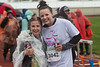 Frome left, Tierra Haag and and her Run Buddy Kristina Harter pose at the finish line after Girls on the Run in Chadron May 19, 2018. (Courtesy photo by Justin Haag)