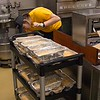 A CSC Dining Services employee loads containers of cheese on a cart to transport to the Chicoine Center for an attempt to set the world record longest taco line Friday, April 21, 2017. (Photo by Tena L. Cook/Chadron State College)