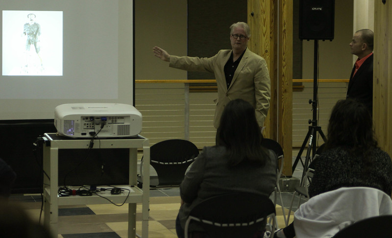 """Dr. Deane Tucker, English and humanities professor, shares details of a piece of art titled """"For America (José Martí)"""" on display in Cuba during a Graves Lecture Series presentation presented with Dr. T. Smith in the Mari Sandoz High Plains Heritage Center Chicoine Atrium, Tuesday, April 17, 2018. (Photo by Kelsey R. Brummels/Chadron State College)"""