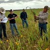 Chadron State College students in a class taught by Dr. Ron Bolze on a field trip to Plum Thicket Farms southeast of Gordon, Nebraska. Co-owner of the farms, Patrick Peterson, right, explains his diverse mix of cover crops. (Courtesy photo by Ron Bolze)