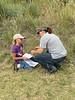 Jeanna Boland, right,  assists Becca Reece with plant identification during Nebraska Extension's Plant Identification, Collection and Range Judging Contest at Chadron State College July 12, 2017. (Tena L. Cook/Chadron State College)
