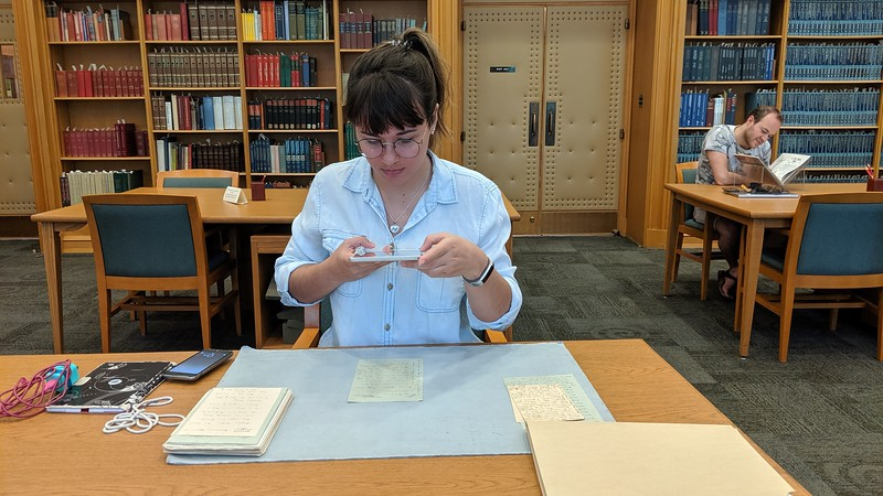 Chadron State College student Rachel Mitchell of Riverton, Wyoming, takes a photo of documents written by the late English essayist Vernon Lee during a May 2019 trip with Dr. Mary Clai Jones, assistant professor, to conduct primary research at the University of Indiana's Lilly Library in Bloomington. (Courtesy photo used with permission)