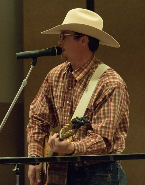 Chadron State College alumnus Nate Smith of Newcastle, Wyoming, entertains the audience during the Black Tie Calf Fry in the Student Center Friday, March 31, 2017. (Photo by Tena L. Cook/Chadron State College)