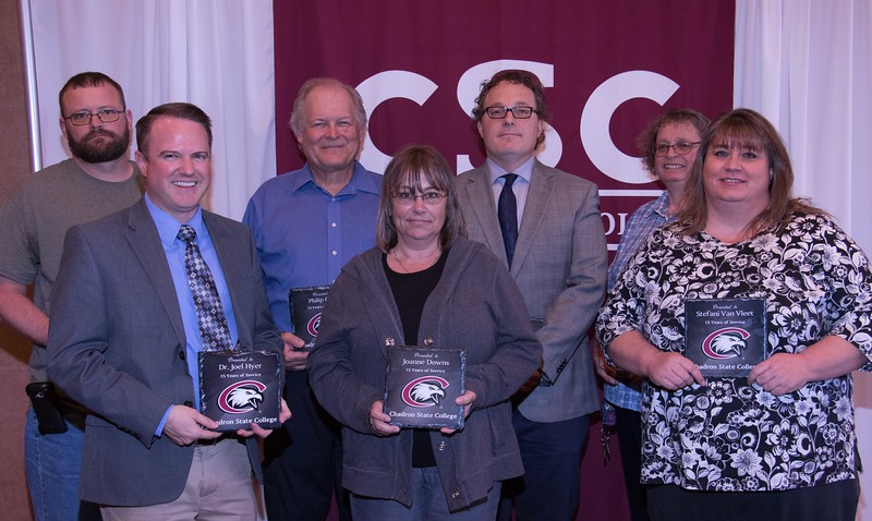 Employees honored for 15 years of service at the annual Chadron State College Faculty and Staff Recognition Luncheon Thursday, April 13, 2017, in the Student Center Ballroom. From left, Todd Baumann, Dr. Joel Hyer, Phil Cary, Joanne Downs, Dr. Matt Evertson, Velinda Malone and Stefani Van Vleet. Not pictured, Kim Bradley. (Photo by Tena L. Cook/Chadron State College)