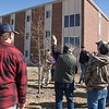 Chadron State College horticulturist Lucinda Mays instructs a group of public landscape managers during CSC's annual tree pruning workshop March 8, 2018, near Kent Hall. (Photo by Tena L. Cook/Chadron State College)
