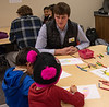 Chadron State College student Nolan Grint of North Loup, Neb., center, helps Kindergarten students from Wolf Creek Elementary School near Pine Ridge, S.D., during Dr. Seuss Day Wednesday, Feb. 27, 2019, at CSC as part of Read Across America. (Tena L. Cook/Chadron State College)