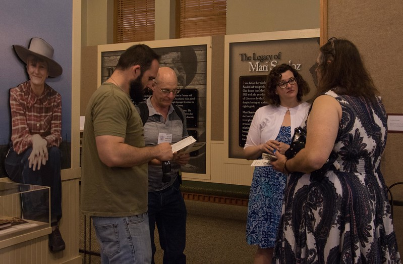 Sarah Polak, second from right, assists members of the Sandoz family visiting the Mari Sandoz High Plains Heritage Center Friday, June 9, 2017, during a five-day Sandoz family reunion. (Photo by Tena L. Cook/Chadron State College)