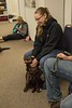 Chadron State College student Kimberly Barent of Rockville, Neb., participates in pet therapy during finals May 3, 2017, in the Project Strive/TRiO office. (Photo by Tena L. Cook/Chadron State College)