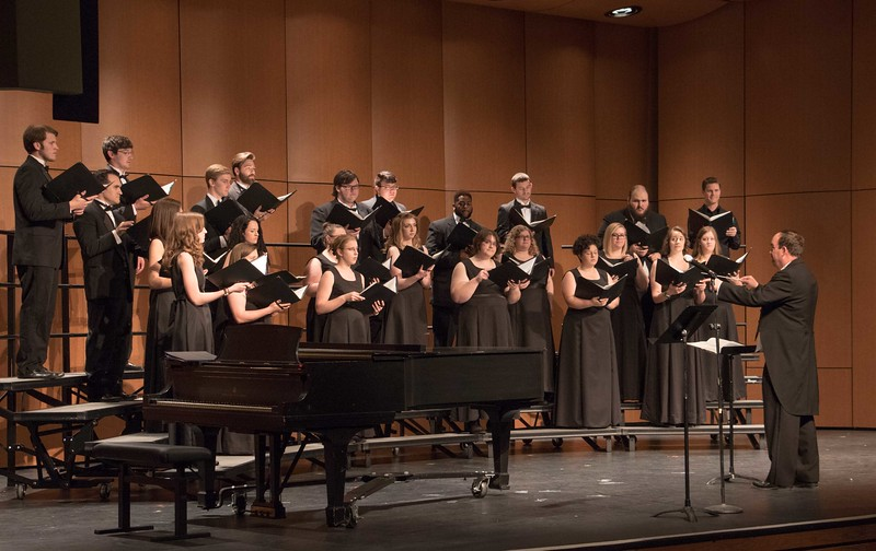 Dr. Joel Schreuder, right, directs the Chadron State College Concert Choir Sunday, April 9, 2017, at Memorial Hall's Auditorium. (Photo by Alex Coon/Chadron State College)