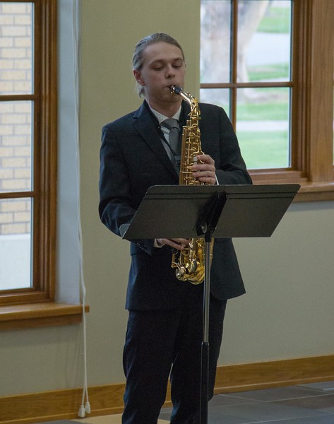 Drew Kasch of Highlands Park, Colorado, performs during a Chadron State College student and faculty composers concert Wednesday, April 26, 2017, in the Sandoz Center Chicoine Atrium. (Photo by Alex Coon/Chadron State College)