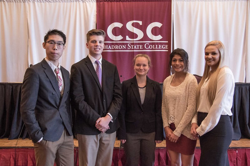 Students accepted into the new Rural Legal Opportunities Program pose following the Nebraska Court of Appeals hearings Tuesday, April 11, 2017, in the Chadron State College Student Center Ballroom. From left, Kevin Zhang, Gunnar Buchhammer, Tindra Norris, Celeste Cardona and Alexandria Nobiling. Not pictured, Elizabeth Adam and Carter Thiele. (Photo by Tena L. Cook/Chadron State College)
