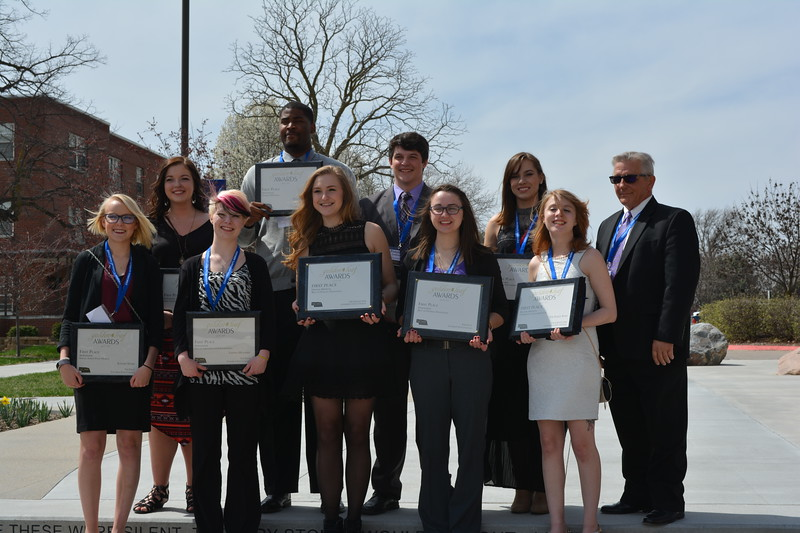 "Staff members of ""The Eagle,"" Chadron State College's student newspaper, pose with their ""Best in Overall Excellence"" awards at the Nebraska Collegiate Media Association's Golden Leaf Awards ceremony in Seward April 8, 2017. Back row, from left, Melanie Nelson, Jay Feltson, Preston Goehring, Shae Brennan and adviser Mike Kennedy. Front row, from left, Justine Stone, Brianna Wilson, Janelle Kesterson, Jordyn Hulinsky and Angie Webb. (Courtesy photo)"