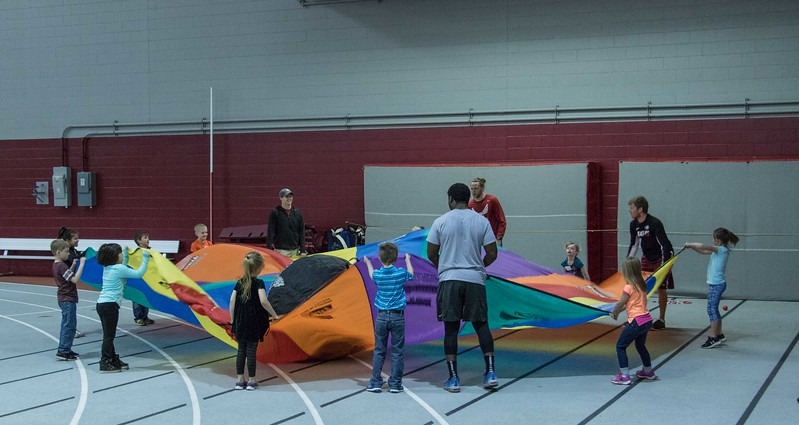 Chadron State College students play with Chadron Elementary first grader students during Challenge Days at Chadron State College Wednesday, April 5, 2017. (Photo by Alex Coon/Chadron State College)