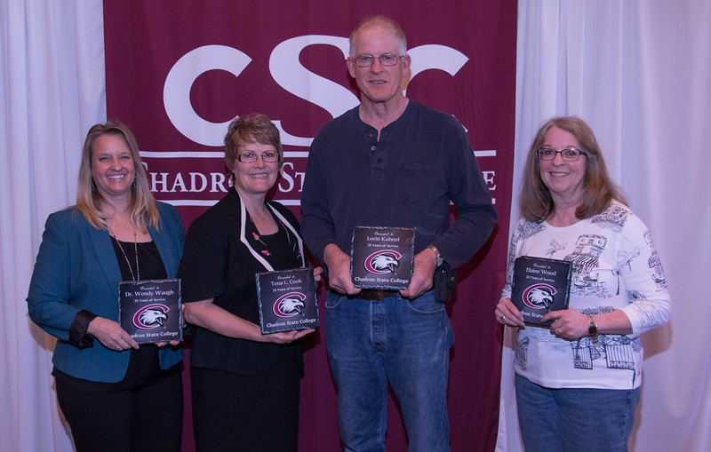 Employees honored for 25 years of service at the annual Chadron State College Faculty and Staff Recognition Luncheon Thursday, April 13, 2017, in the Student Center Ballroom. From left, Dr. Wendy Waugh, Tena Cook, Lorin Kuhnel and Elaine Wood. (Photo by Alex Helmbrecht/Chadron State College)