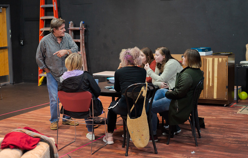 """Roger Mays, professor of visual and performing arts, directs the cast of """"The Odd Couple"""" during a rehearsal. (Photo by Daniel Binkard/Chadron State College)"""