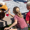 A young fan shares a high five with Elmo at the Chadron State College Sports Complex Dedication Saturday, Sept. 15, 2018. (Photo by Tena L. Cook/Chadron State College)