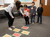 Chadron State College student Mackenzie McMahon of Chadron, left, helps Kindergarten students from Wolf Creek Elementary School near Pine Ridge, S.D., during Dr. Seuss Day Wednesday, Feb. 27, 2019, at CSC as part of Read Across America. (Tena L. Cook/Chadron State College)