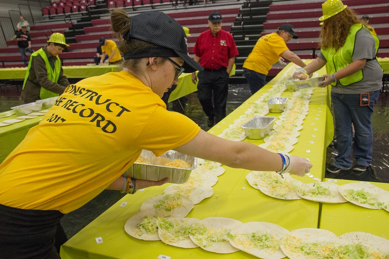 CSC Dining Services  filling 2,017 soft shells in an attempt to set the world's record Friday, April 21, 2017 in the Chicoine Center. (Photo by Tena L. Cook/Chadron State College)