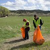 CSC Art Guild members Matthew Ellis of Alliance, left, and Tristan Stephenson of Alliance, right, pick up trash next to Highway 20 east of Chadron for The Big Event Saturday, April 22, 2017. (Photo by Tena L. Cook/Chadron State College)