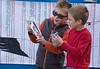 Students at Chadron State College's Child Development Center examine bird guides during Family Nature Night, A Week of the Young Child activity, Wednesday, April 18, 2018. (Photo by Tena L. Cook/Chadron State College)