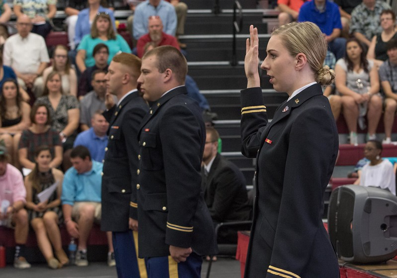 Three second lieutenants, graduates of the CSC Army ROTC program, take their oaths during Chadron State College's undergraduate commencement at the Chicoine Center May 6, 2017. From left, Josh Mayer, Evan Oakley and Mackenzie Watson. (Photo by Tena L. Cook/Chadron State College)