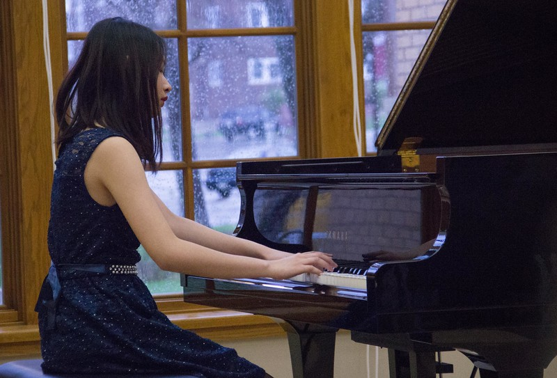 Chadron State College music student Yen Nguyen performs at the Piano Studio Recital Thursday, April 27, 2017, in the Sandoz Center Chicoine Atrium. (Photo by Tena L. Cook/Chadron State College)