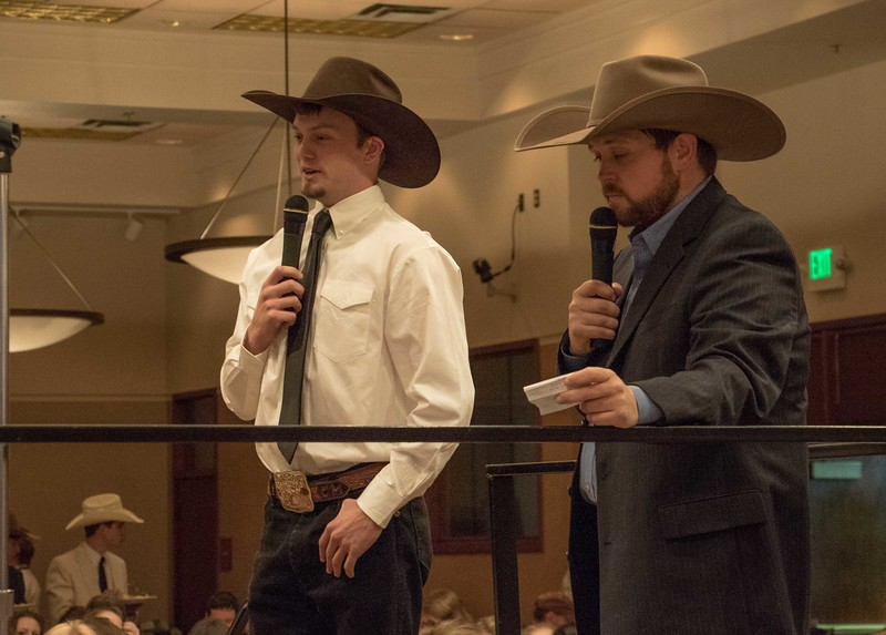 Chadron State College rodeo team member Cordale Martin of Panhandle, Texas, left, speaks to the audience at the Black Tie Calf Fry in the Student Center Friday, March 31, 2017. (Photo by Tena L. Cook/Chadron State College)