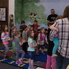 Students and staff at the CSC Child Development Center march and sing along to a song played by Dr. Sidney Shuler during a music lesson Monday, April 24, 2017. Guests visit during the Week of the Young Child. (Photo by Kelsey R. Brummels/Chadron State College)