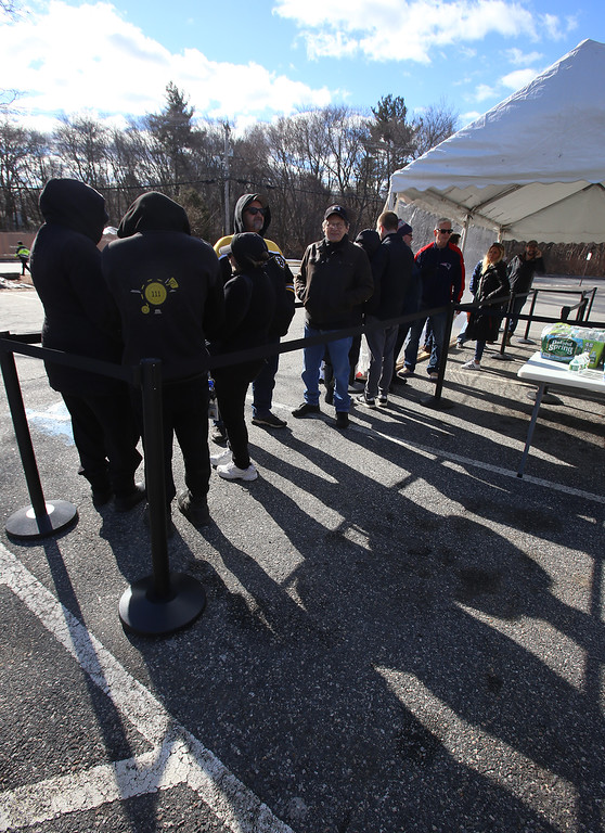 . First day of adult use recreational marijuana sales at Patriot Care in Lowell. Early arrivals wait in the adult use/recreational line around 9:45am for an 11am opening to the public. (SUN Julia Malakie)