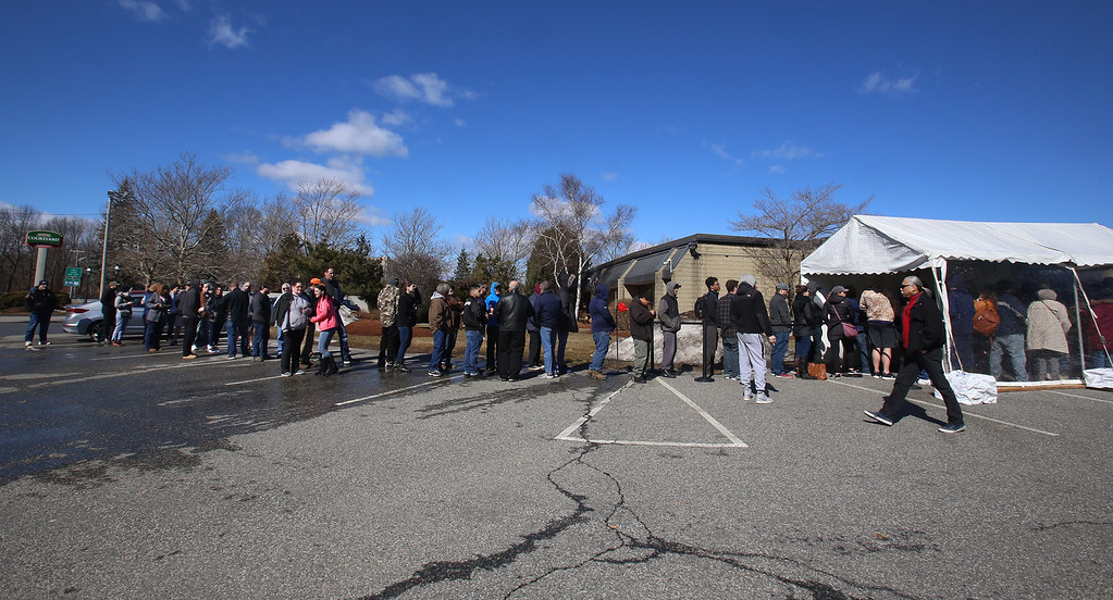 . Line on the first day of adult use recreational marijuana sales at Patriot Care in Lowell. (SUN Julia Malakie)