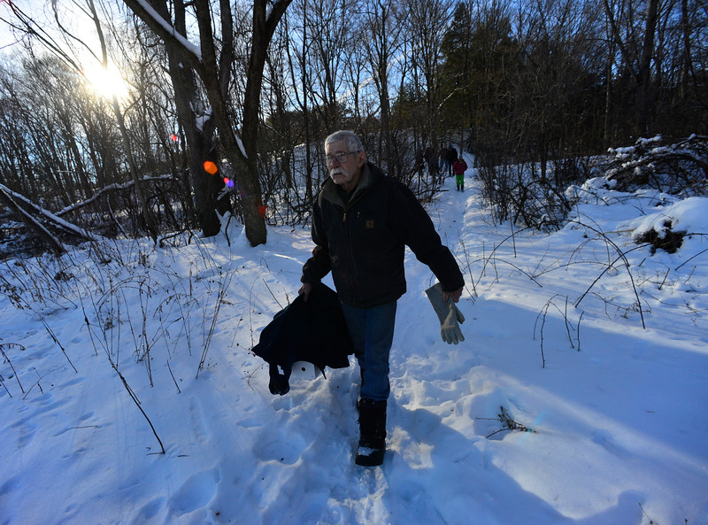 KRISTOPHER RADDER - BRATTLEBORO REFORMER<br /> Fred Homer, of Williamsville, Vt., carries the snowy owl in a carrier as he heads to an open field in Putney to release the bird on Wednesday, Jan. 10, 2018.