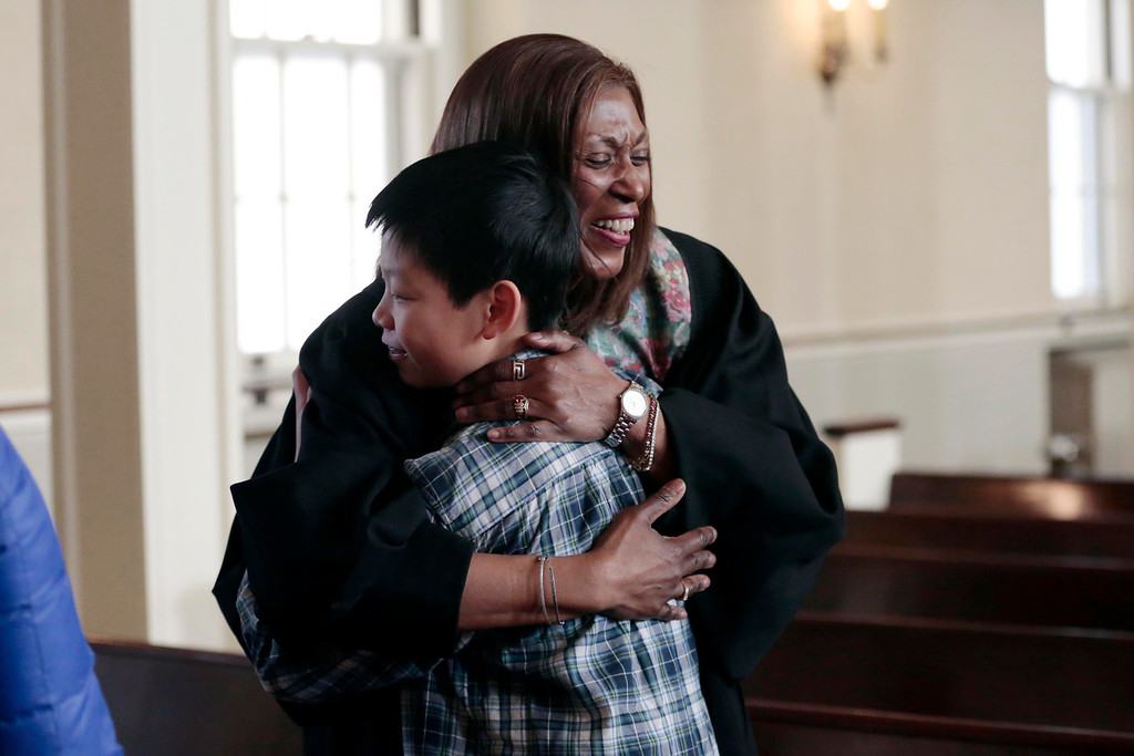 . The Rev. Sheila Sholes-Ross, the new pastor at First Baptist Church in Pittsfield, greets Chenyang Lin, 13, after Sunday service. Sunday, January 26, 2014. (Stephanie Zollshan | Berkshire Eagle Staff)