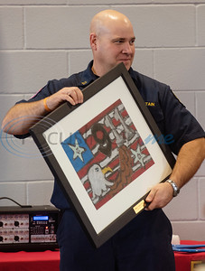 Captain Zach Powers receives a gift from Jack Elementary School students during the grand opening of the relocated Tyler Fire Station No. 4 on Monday, Feb. 3, 2020 at 7445 Cherryhill Drive.  (Sarah A. Miller/Tyler Morning Telegraph)