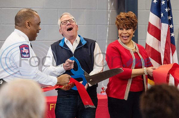 Chief David Coble, left and City Council members Don Warren and Shirley McKellar hold a ribbon cutting during the grand opening of the relocated Tyler Fire Station No. 4 on Monday, Feb. 3, 2020 at 7445 Cherryhill Drive.  (Sarah A. Miller/Tyler Morning Telegraph)