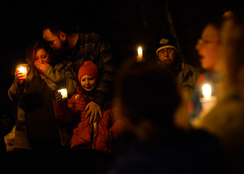 "KRISTOPHER RADDER - BRATTLEBORO REFORMER<br /> Justin Park kisses the head of his wife Stephanie while holding his 10-year-old daughter Georgia tightly as a group sings  ""A Thousand Years"" during a vigil for Keyton Marrotte, 10, of Winchester, N.H., on Monday, Dec. 18, 2017."