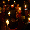"KRISTOPHER RADDER - BRATTLEBORO REFORMER<br /> People hold their candles into the air while a small group of children sings ""A Thousand Years"" during a vigil for Keyton Marrotte, 10, of Winchester, N.H., on Monday, Dec. 18, 2017."