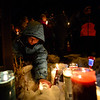 KRISTOPHER RADDER - BRATTLEBORO REFORMER<br /> Mary Sunburn, 8, places a candle in the snow during a vigil for Keyton Marrotte, 10, of Winchester, N.H., on Monday, Dec. 18, 2017.