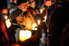 KRISTOPHER RADDER - BRATTLEBORO REFORMER<br /> Tahako Ueda holds a candle during a candlelight vigil at Plaza Park, in Brattleboro, Vt., to mark the fourth anniversary of the Sandy Hook Elementary shooting, in Sandy Hook, Conn., on Wednesday, Dec. 14, 2016.