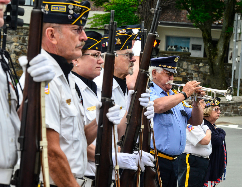 KRISTOPHER RADDER - BRATTLEBORO REFORMER<br /> Don Strange, of the American Legion Post 5 plays taps during a wreath-laying ceremony at the Kyle Gilbert Memorial Bridge, in Brattleboro, Vt., on Monday, May 28, 2018.