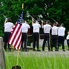 KRISTOPHER RADDER - BRATTLEBORO REFORMER<br /> Members of the Brattleboro American Legion's Color Guard fired a salute during a small ceremony at St. Michael's Cemetery on Memorial Day.